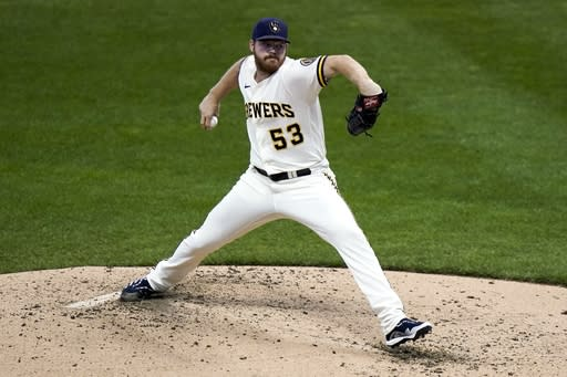 Milwaukee Brewers starting pitcher Brandon Woodruff throws during the third inning of the first game of a baseball doubleheader against the St. Louis Cardinals Wednesday, Sept. 16, 2020, in Milwaukee. (AP Photo/Morry Gash)