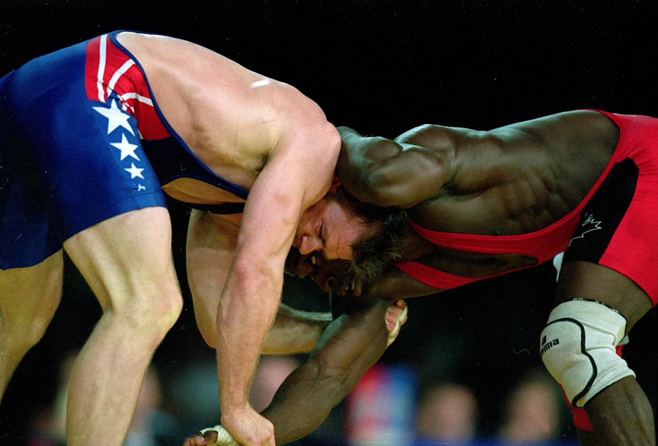 1 Oct 2000: Linclon Mc Ilravy of the USA tries to flip Daniel Igali of Canada during the Men's Freestyle Wrestling 69kg Event at the Sydney Exhibition Hall for the 2000 Sydney Olympics in Sydney, Australia.Mandatory Credit: Scott Barbour/AUS /Allsport