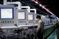 FILE PHOTO: An employee works on the production line of electric vehicle (EV) battery manufacturer Octillion in Hefei