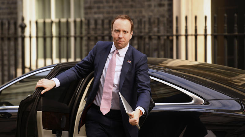 Britain's Health Secretary Matt Hancock arrives in Downing Street, London, Tuesday April 14, 2020. Prime Minister Boris Johnson remains in convalescence at his country home of Chequers, following his hospialisation with the coronavirus.  The highly contagious COVID-19 coronavirus has impacted on nations around the globe, many imposing self isolation and exercising social distancing when people move from their homes. (Stefan Rousseau / PA via AP)