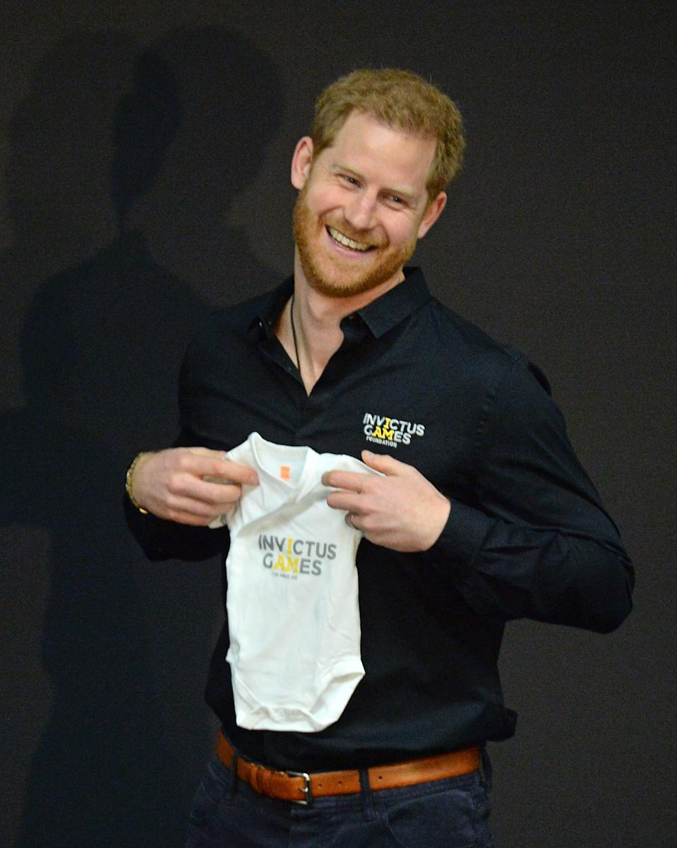 The Duke of Sussex receives a gift for his new son Archie during a visit to The Hague [Photo: PA]