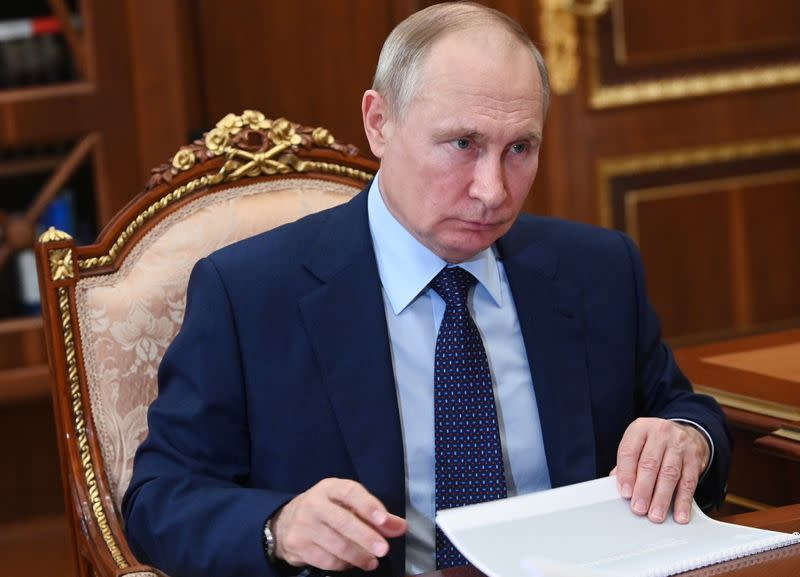 FILE PHOTO:Russian President Putin meets with Governor of Sevastopol Razvozhayev in Moscow