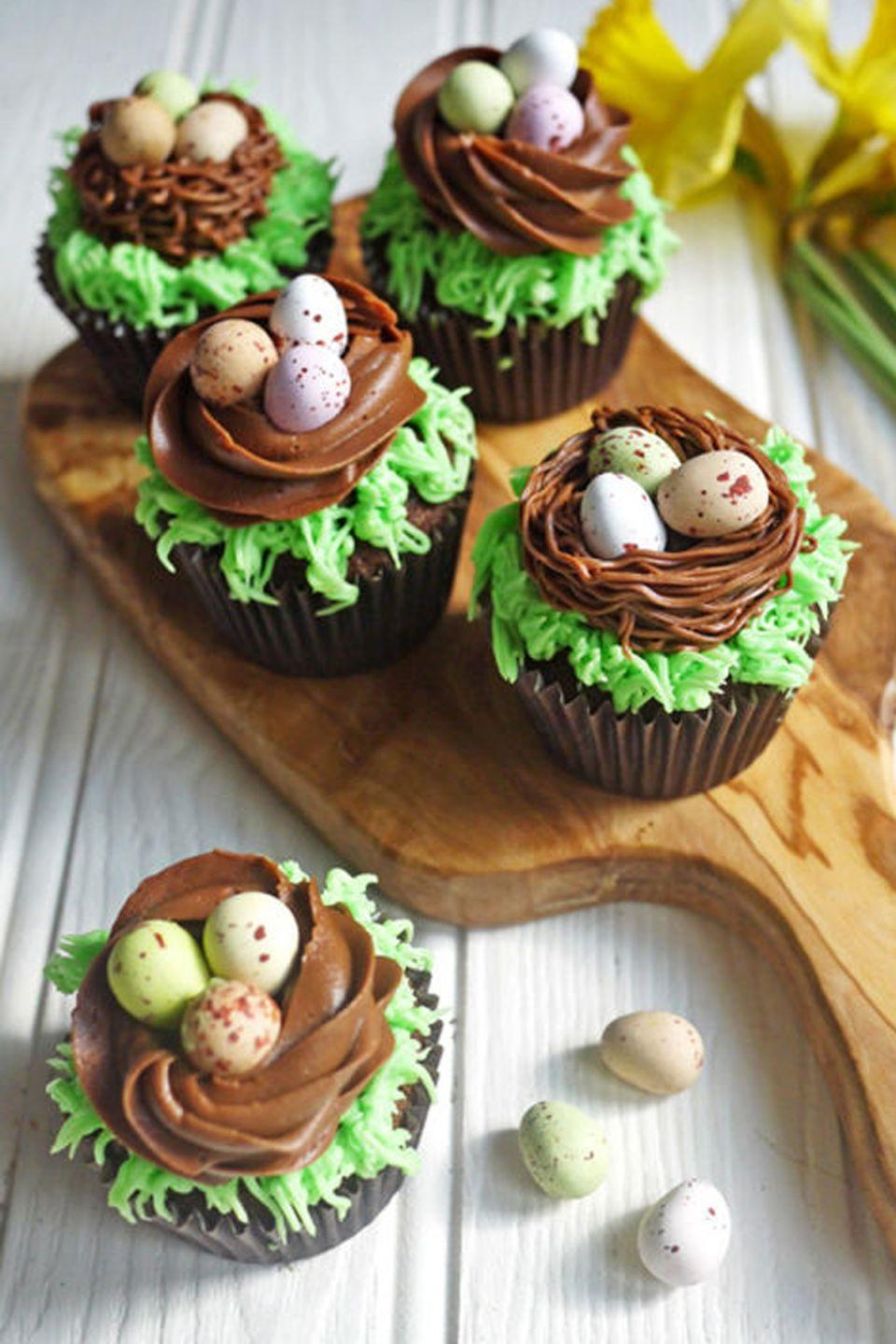 """<p>As if you needed another excuse to devour a whole bag of Cadbury eggs. </p><p><em><a href=""""https://www.tamingtwins.com/easter-chocolate-nest-mini-egg-cupcakes-kids-cooking/"""" rel=""""nofollow noopener"""" target=""""_blank"""" data-ylk=""""slk:Get the recipe from Taming Twins »"""" class=""""link rapid-noclick-resp"""">Get the recipe from Taming Twins »</a></em></p><p><strong>RELATED: </strong><a href=""""https://www.goodhousekeeping.com/food-recipes/dessert/g3328/cadbury-egg-recipes/"""" rel=""""nofollow noopener"""" target=""""_blank"""" data-ylk=""""slk:25 Amazing Desserts You Can Make With Cadbury Eggs"""" class=""""link rapid-noclick-resp"""">25 Amazing Desserts You Can Make With Cadbury Eggs</a></p>"""
