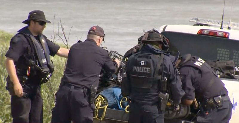 Pictured is RCMP officers preparing a search in and near the Nelson River, Manitoba.