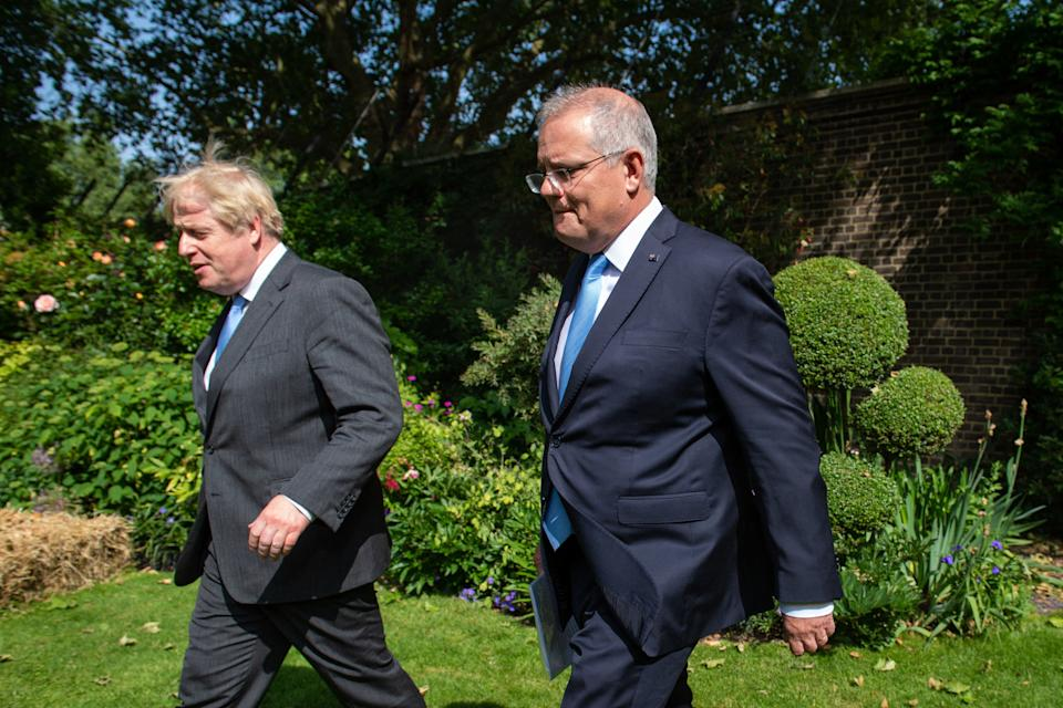 Prime minister Boris Johnson with his Australian counterpart Scott Morrison walk in the garden of 10 Downing street in London on 15 June. Photo: Dominic Lipinski/AFP via Getty Images