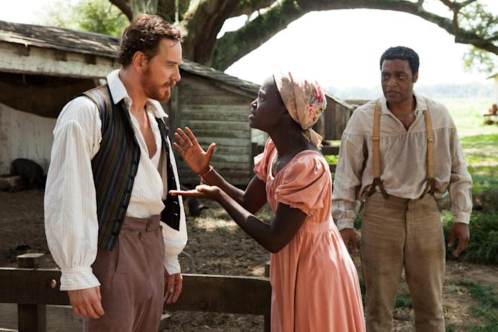 "Michael Fassbender, Lupita Nyong'o and Chiwetel Ejiofor act in a scene from the 2012 film ""12 Years A Slave."""