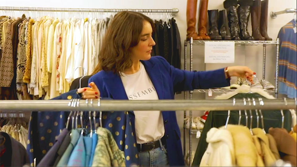 Reporter looks through clothing racks SWOP newtown