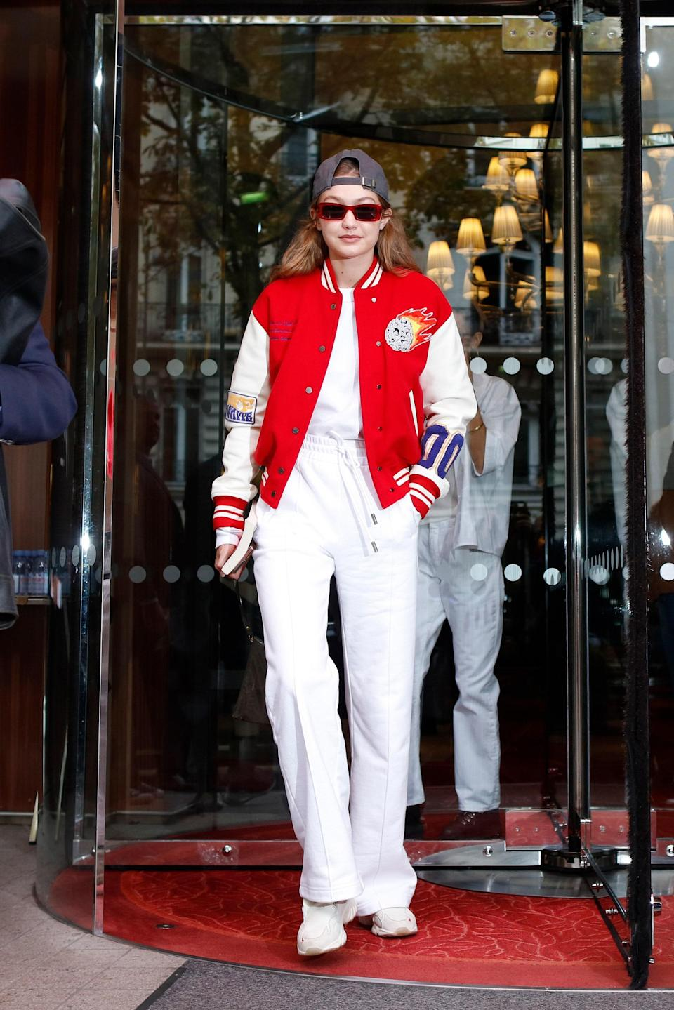 Batter up! Gigi put an even sportier spin on this athleisure look, pairing a red, white, and blue baseball jacket with a white sweatshirt and matching joggers and capping it all off with a backward hat. TBH, we'll be rooting for Team Gigi all season long.