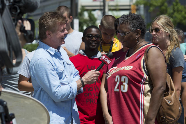 A Cleveland Cavaliers fan talks with a reporter outside of The Quicken Loans Arenao n July 11, 2014 in Cleveland, Ohio (AFP Photo/Angelo Merendino)