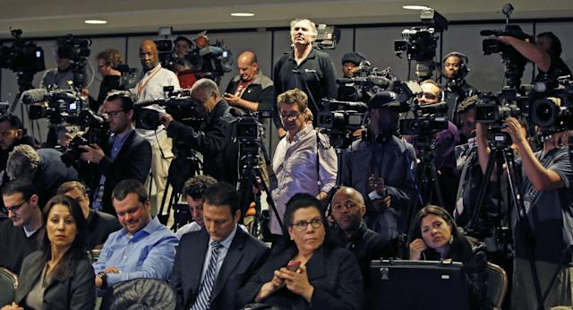 Journalists wait for NBA Commissioner Adam Silver to address a news conference in New York, Tuesday, April 29, 2014. Silver announced that Los Angeles Clippers owner Donald Sterling has been banned for life by the league in response to racist comments the league says he made in a recorded conversation. (AP Photo/Kathy Willens)