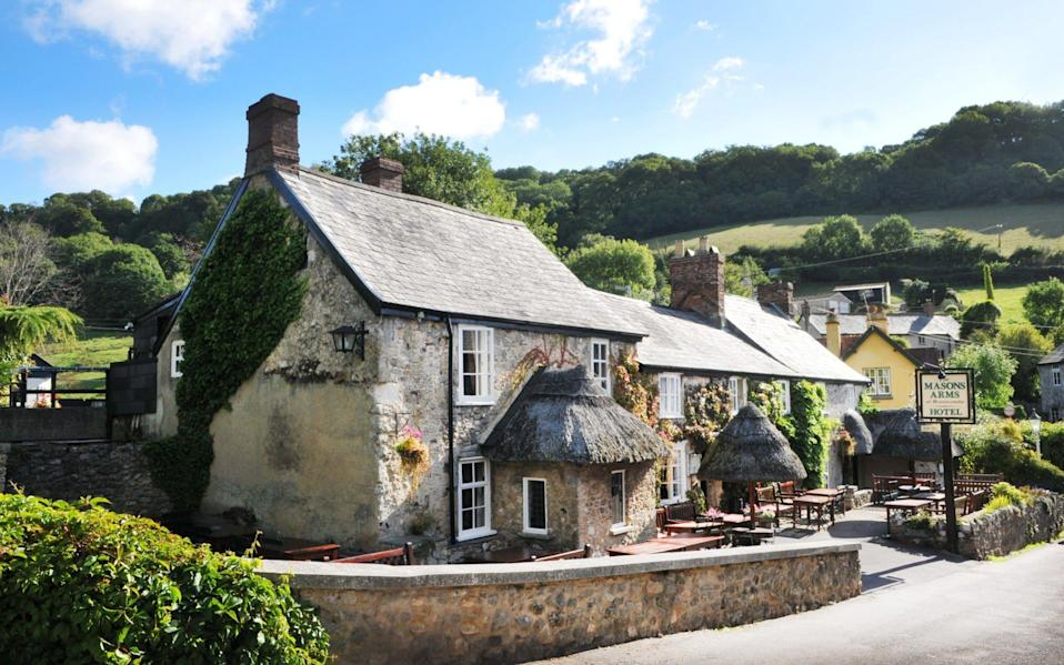 The Masons Arms is a 14th-century thatched inn with rooms in a quiet spot inland from Branscombe Beach