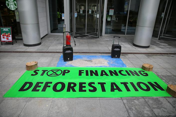 An Extinction Rebellion banner lies outside BlackRock offices during a protest against the climate crisis and destruction of the Amazonia fires. Photo: Steve Taylor/SOPA Images/LightRocket via Getty Images