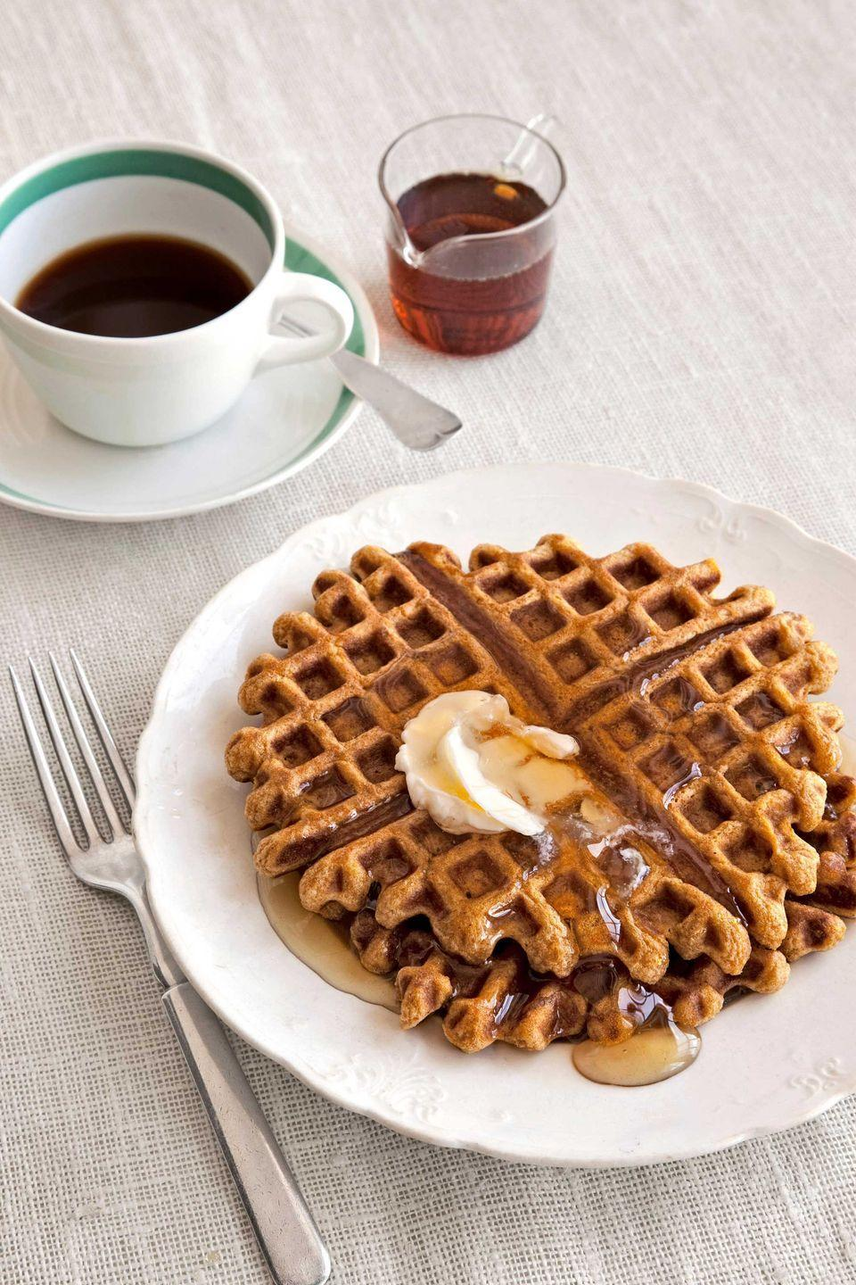 """<p>The unexpected punch of crystallized ginger gives tender pumpkin waffles a grown-up twist. </p><p><strong><a href=""""https://www.countryliving.com/food-drinks/recipes/a2992/pumpkin-ginger-waffles-recipe/"""" rel=""""nofollow noopener"""" target=""""_blank"""" data-ylk=""""slk:Get the recipe"""" class=""""link rapid-noclick-resp"""">Get the recipe</a>.</strong></p>"""