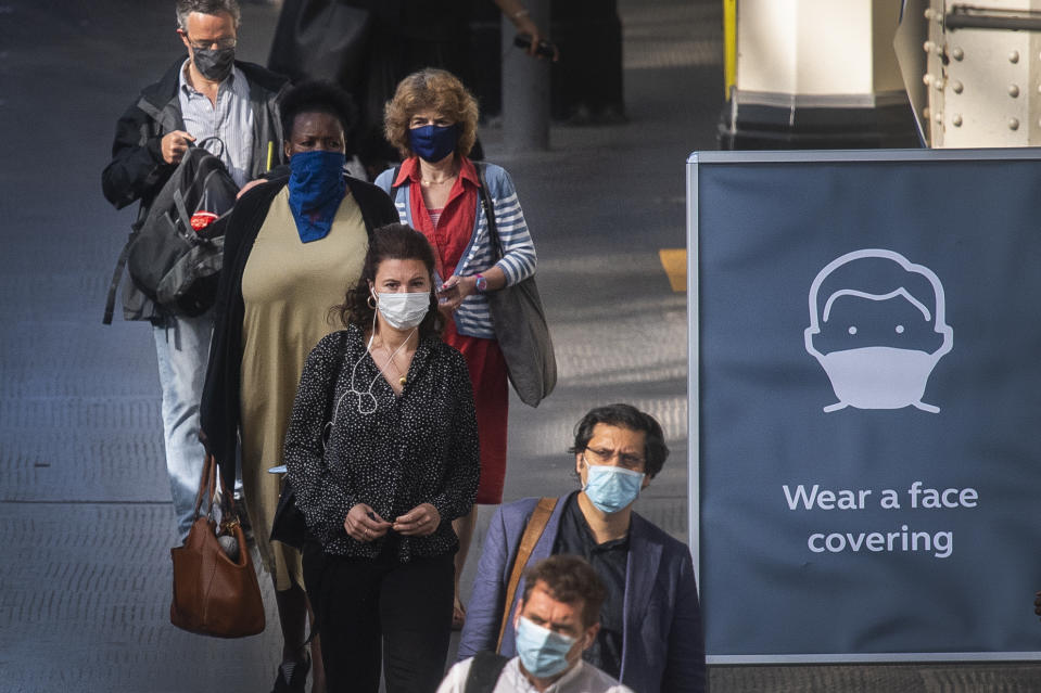 Passengers wearing face masks at Waterloo station in London as face coverings become mandatory on public transport in England with the easing of further lockdown restrictions during the coronavirus pandemic. (Photo by Victoria Jones/PA Images via Getty Images)