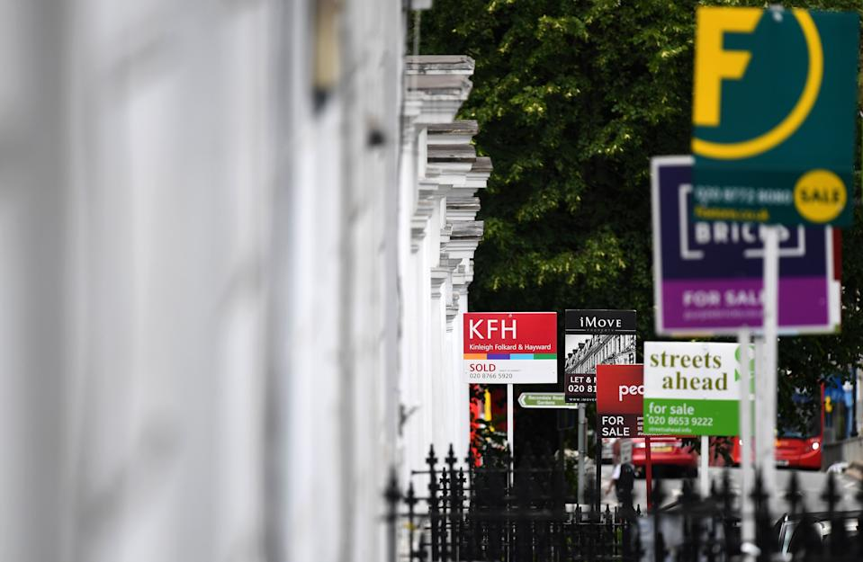 """Estate Agents' """"For Sale"""", """"Sold"""", and """" To-Let"""" boards are pictured outside residential properties in south London on July 6, 2020. - British media reported Monday that Britain's Chancellor of the Exchequer Rishi Sunak is set to outline plans to raise the threshold at which homebuyers pay Stamp Duty on their new properties, currently set at GBP 125,000. (Photo by DANIEL LEAL-OLIVAS / AFP) (Photo by DANIEL LEAL-OLIVAS/AFP via Getty Images)"""