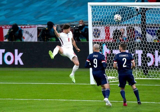 England's John Stones sees his header hit the post