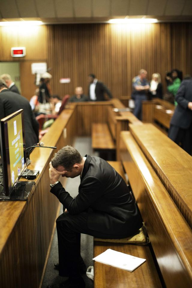 Olympic and Paralympic track star Oscar Pistorius holds his head after the fourth day of his trial for the murder of his girlfriend Reeva Steenkamp at the North Gauteng High Court in Pretoria, March 6, 2014. REUTERS/Marco Longari/Pool (SOUTH AFRICA - Tags: SPORT ATHLETICS CRIME LAW)