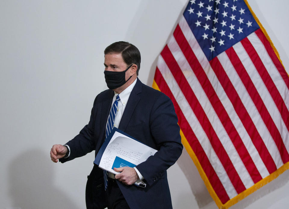 Arizona Gov. Doug Ducey leaves after a news conference about COVID-19, Thursday, July 16, 2020, in Phoenix. (Cheryl Evan/The Arizona Republic via AP, Pool)