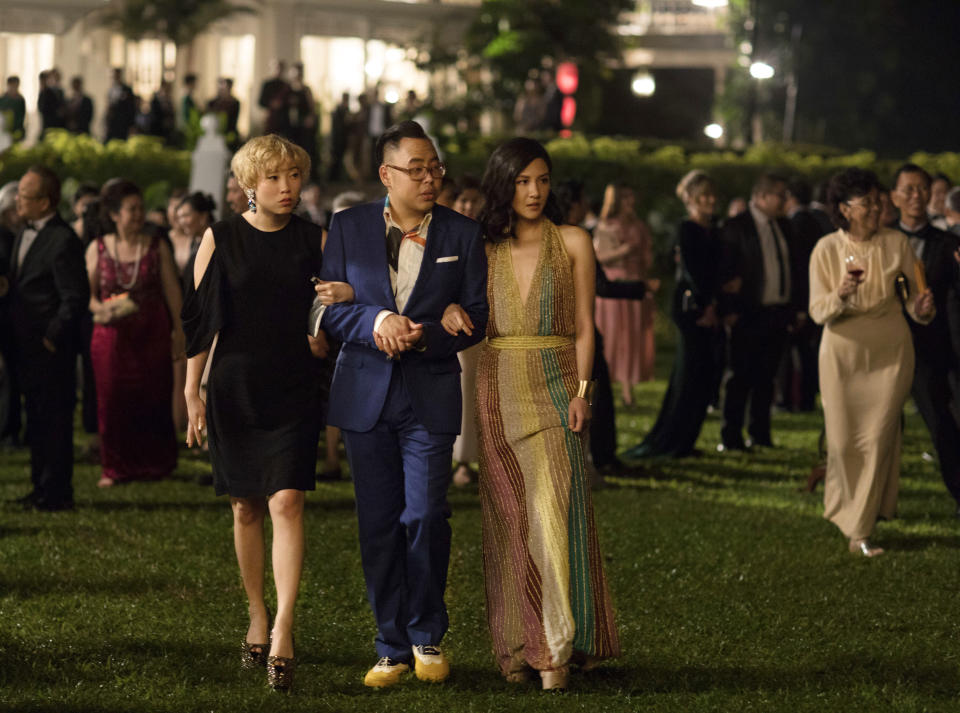 """This image released by Warner Bros. Entertainment shows, from left, Awkwafina, Nico Santos, and Constance Wu in a scene from the film """"Crazy Rich Asians."""" (Sanja Bucko/Warner Bros. Entertainment via AP)"""