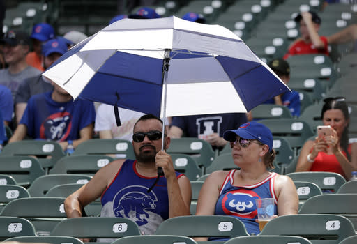 Chicago Cubs fans sit as they wait for a baseball game between the San Diego Padres and the Chicago Cubs in Chicago, Saturday, July 20, 2019. (AP Photo/Nam Y. Huh)