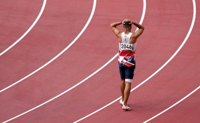 Adam Gemili walks the track after pulling up injured during the men's 200m heats