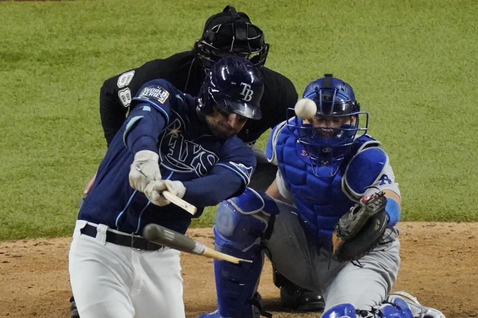 Tampa Bay Rays' Kevin Kiermaier hits a single against the Los Angeles Dodgers during the ninth inning in Game 4 of the baseball World Series Saturday, Oct. 24, 2020, in Arlington, Texas. (AP Photo/Sue Ogrocki)