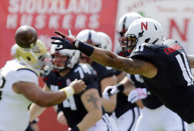 Nebraska tight end Cethan Carter (11) can't reach a pass from quarterback Taylor Martinez in the first half of an NCAA college football game against UCLA in Lincoln, Neb., Saturday, Sept. 14, 2013. (AP Photo/Nati Harnik)