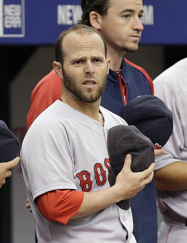 Boston Red Sox's Dustin Pedroia stands in front of pitcher Allen Webster during the playing of the national anthem before a baseball game against the Tampa Bay Rays, Sunday, Aug. 31, 2014, in St. Petersburg, Fla. Pedroia was injured in Saturday night's game after colliding with Rays' Logan Forsythe. (AP Photo/Chris O'Meara)