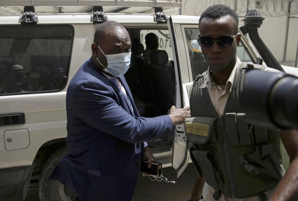 Haiti's General Prosecutor Bed-Ford Claude, who is investigating the assassination of President Jovenel Moise, arrives to his office in Port-au-Prince, Wednesday, July 14, 2021. Moise was assassinated on July 7. (AP Photo/Joseph Odelyn)