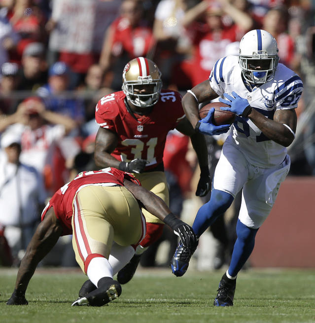 Indianapolis Colts wide receiver Reggie Wayne (87) runs past San Francisco 49ers linebacker Patrick Willis and safety Donte Whitner (31) during the second half of an NFL football game in San Francisco, Sunday, Sept. 22, 2013. (AP Photo/Aaron Kehoe)