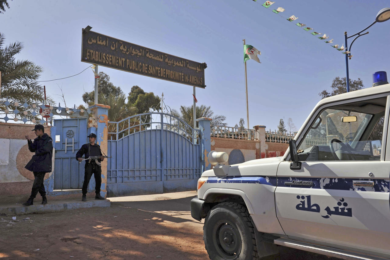 Algerian special police unit officers guard the entrance of an hospital located near the gas plant where hostages have been kidnapped by Islamic militants, in Ain Amenas, Saturday, Jan. 19, 2013. Algeria's special forces stormed the natural gas complex in the middle of the Sahara desert in a final assault Saturday, killing 11 militants, but not before they in turn killed seven hostages, the state news agency reported.(AP Photo/Anis Belghoul)