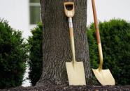 Placards with the seal of the President of the United States mark a shovel used in past White House tree planting ceremonies before first lady Jill Biden holds an Arbor Day tree planting ceremony at the White House, Friday, April 30, 2021, in Washington. (AP Photo/Evan Vucci)
