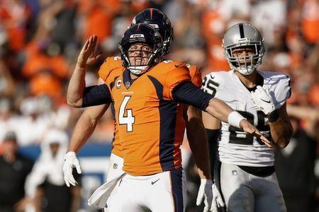 Sep 16, 2018; Denver, CO, USA; Denver Broncos quarterback Case Keenum (4) reacts ahead of tight end Jeff Heuerman (82) and Oakland Raiders safety Erik Harris (25) after a play in the fourth quarter against the Oakland Raiders at Broncos Stadium at Mile High. Mandatory Credit: Isaiah J. Downing-USA TODAY Sports