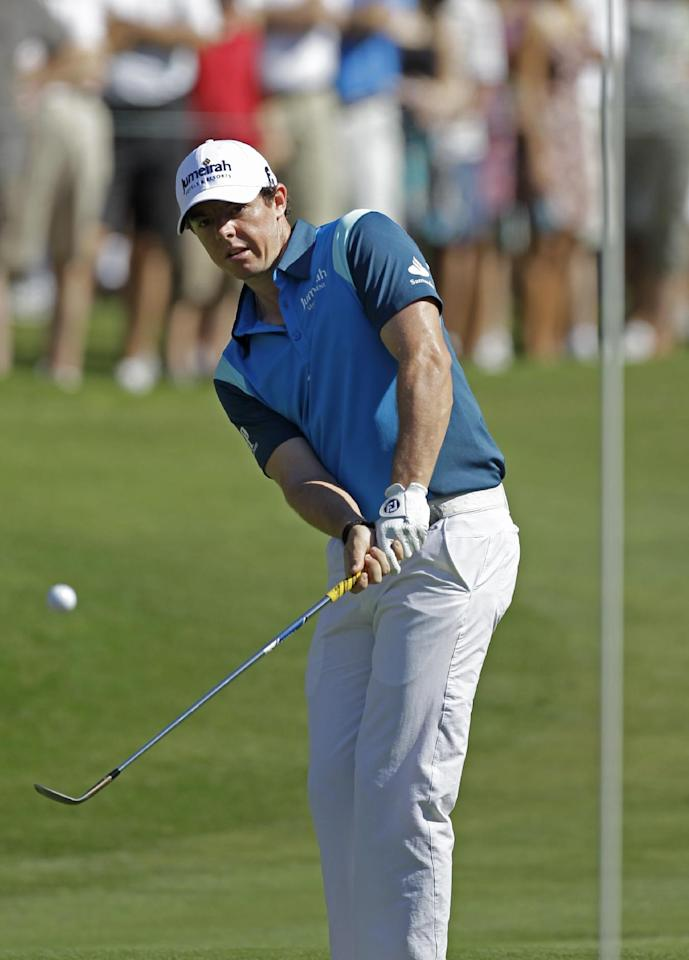 Rory McIlroy, of Northern Ireland, watches his chip to the 14th green during the second round of the Players Championship golf tournament at TPC Sawgrass, Friday, May 11, 2012, in Ponte Vedra Beach, Fla. (AP Photo/Chris O'Meara)