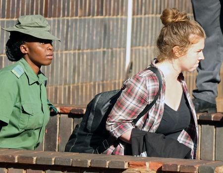 U.S. citizen Martha O'Donovan is led into a remand truck outside court in Harare