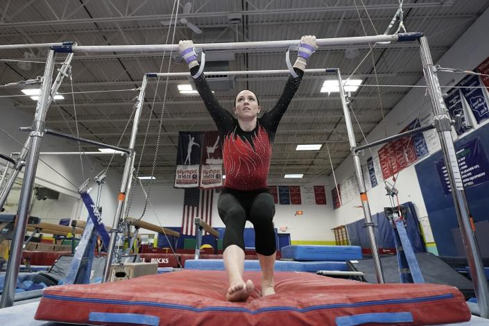 Chellsie Memmel works out Thursday, Feb. 18, 2021, in New Berlin, Wis. The former gymnastics world champion and Olympic silver medalist is attempting to return to competition following a nearly decade-long break. (AP Photo/Morry Gash)