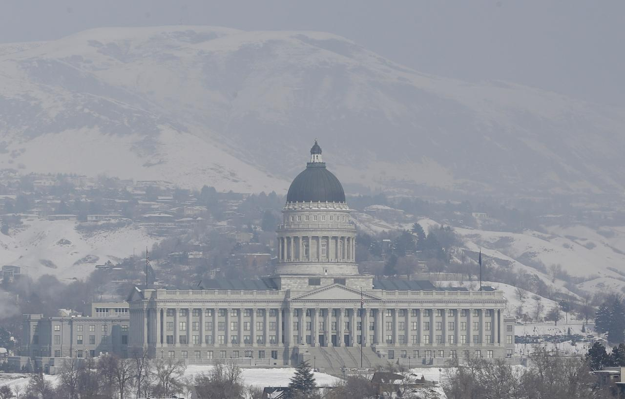 Smog from an inversion hangs over the Utah State Capitol Wednesday, Jan. 23, 2013, in Salt Lake City.  The U.S. Environmental Protection Agency has singled out the greater Salt Lake region as having the nation's worst air for much of January, when an icy fog smothers mountain valleys for days or weeks at a time and traps lung-busting soot. (AP Photo/Rick Bowmer)