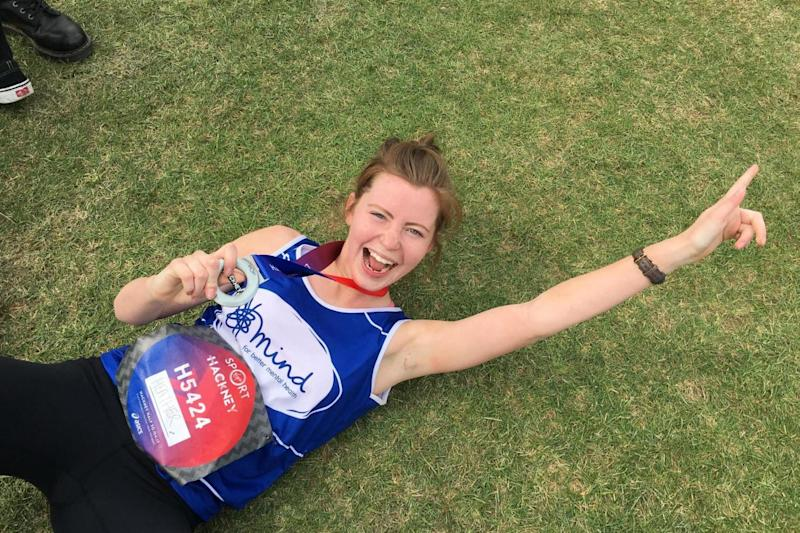 Champion: A runner celebrates after completing the route