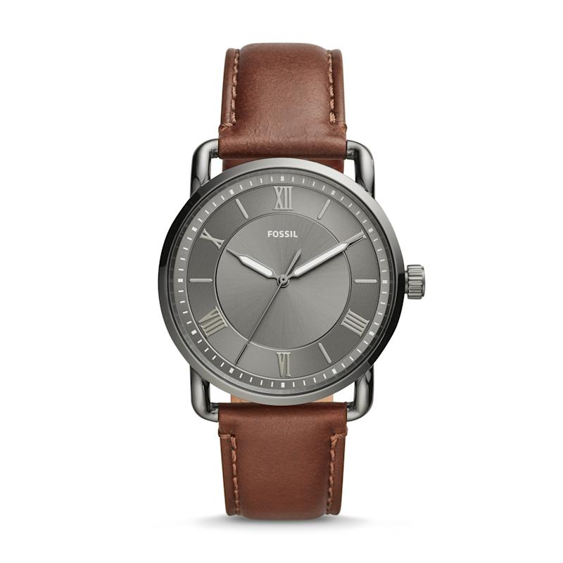 Featuring a gray sun ray dial and a smooth leather strap, this watch is the perfect accessory for any outfit. (Photo: Fossil)