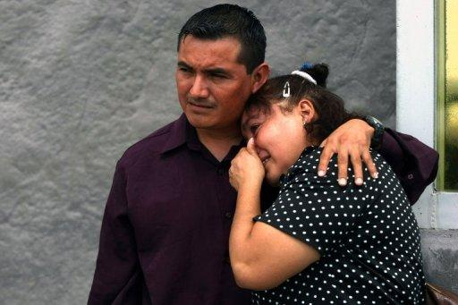 Relatives of victims of a fire in the gas plant of Mexican energy giant PEMEX cry outside the General Attorney's office