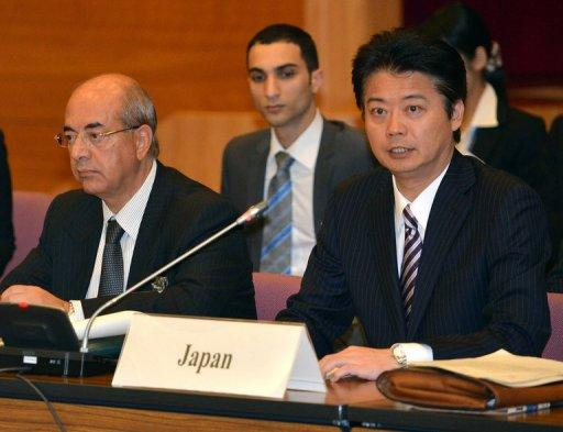 Japanese FM Koichiro Gemba (R) delivers an opening speech during the 5th meeting of the 'Friends of Syria' group