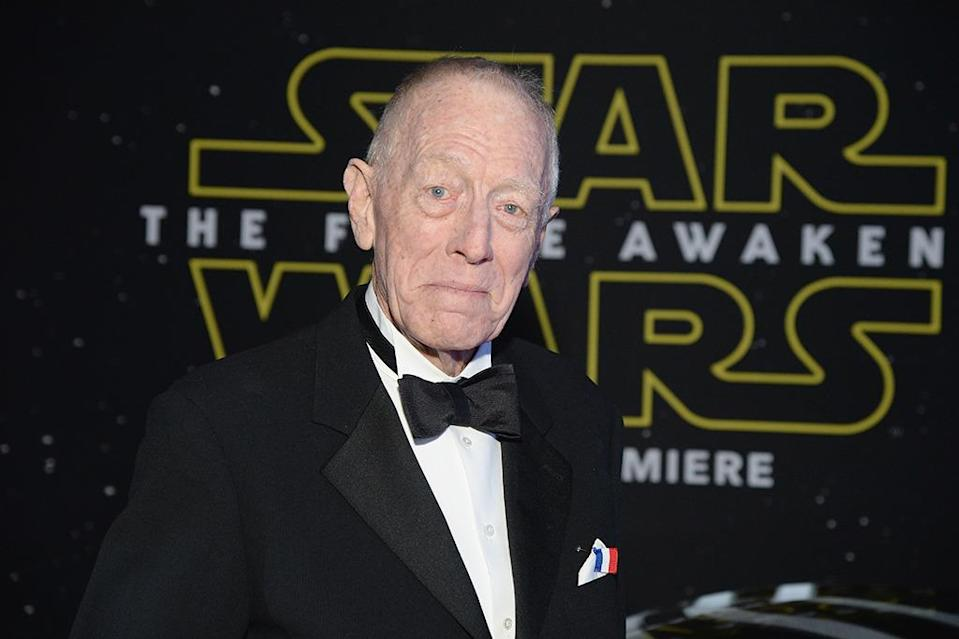 """<p>Now, we know that <i>Exorcist</i> star Max Von Sydow's role in <i>The Force Awakens</i> is a brief one, of """"old ally"""" Lor San Tekka. But early reports suggested that he might be <a href=""""http://www.aintitcool.com/node/67205"""" rel=""""nofollow noopener"""" target=""""_blank"""" data-ylk=""""slk:the movie's big bad"""" class=""""link rapid-noclick-resp"""">the movie's big bad</a>, a<a href=""""http://birthmoviesdeath.com/2014/10/01/episode-vii-news-blast-who-is-max-von-sydow-where-does-daisy-ridley-live-an"""" rel=""""nofollow noopener"""" target=""""_blank"""" data-ylk=""""slk:cyborg with dementia"""" class=""""link rapid-noclick-resp""""> cyborg with dementia</a>, and even <a href=""""http://nerdist.com/star-wars-the-force-awakens-rumor-max-von-sydow-is-boba-fett/"""" rel=""""nofollow noopener"""" target=""""_blank"""" data-ylk=""""slk:an older, retired version"""" class=""""link rapid-noclick-resp"""">an older, retired version</a> of fan favorite Boba Fett. (Photo by Michael Kovac/Getty Images for Dodge)</p>"""