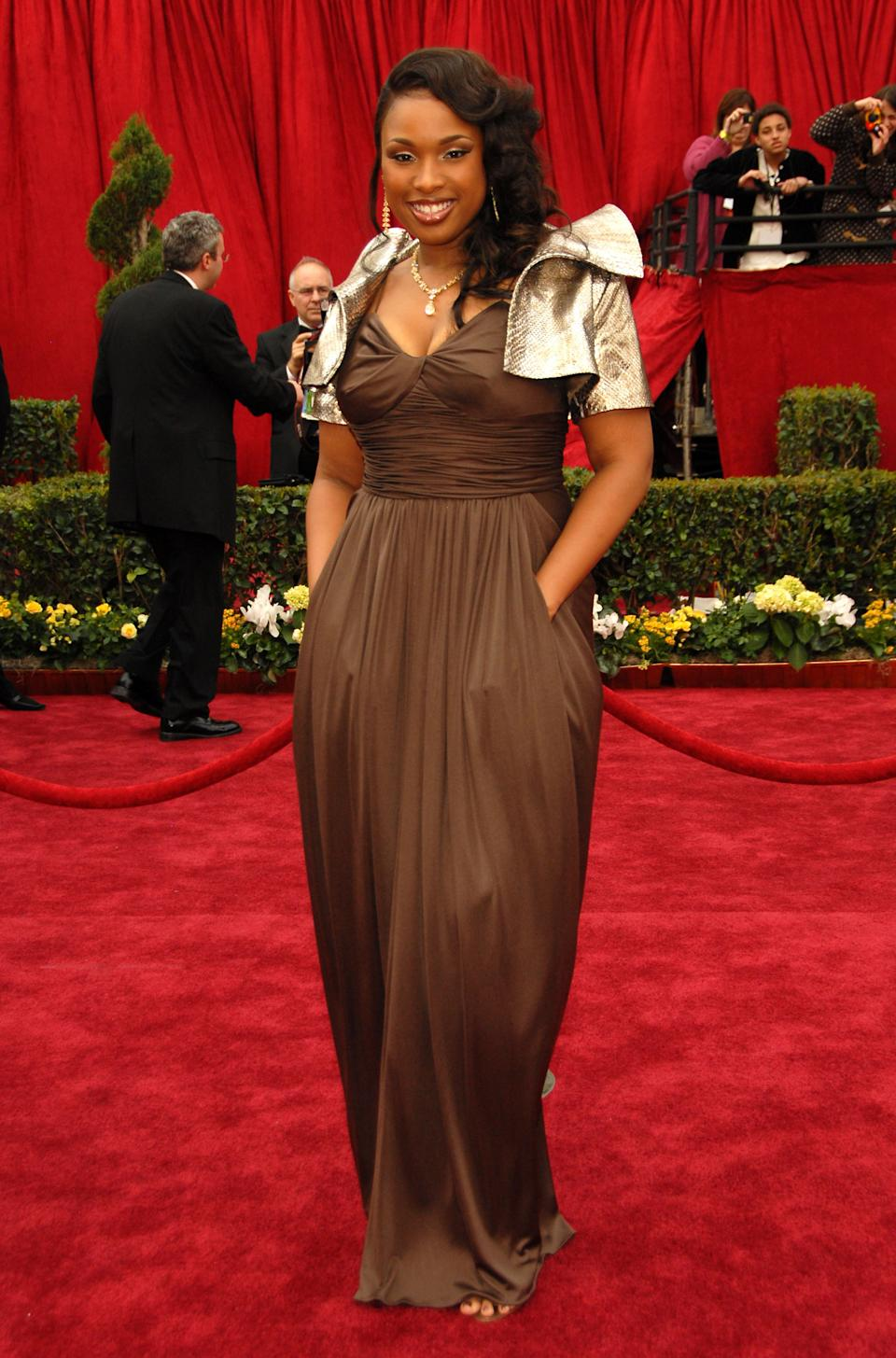 """<p>The """"Dreamgirls"""" star had a red carpet foible before taking home the award for Best Supporting Actress. Luckily, Hudson ditched the silver bolero before mixing metals with her gold statue.</p>"""
