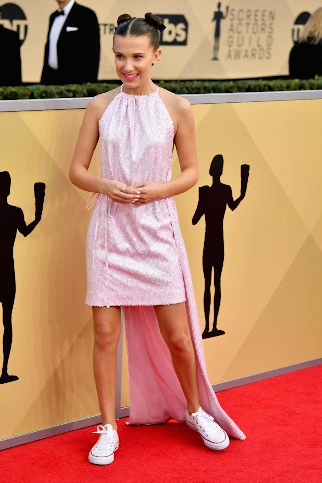 <p>The 13-year-old actress paired Converse sneakers with her high-low dress. (Photo: Getty Images) </p>