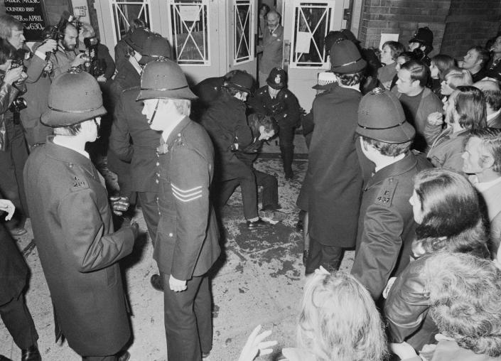 Protestors are restrained by police as the pro-paedophile activist group, the Paedophile Information Exchange (PIE) holds its first open meeting at Conway Hall in Red Lion Square, London, 19th September 1977. Members of PIE were attacked and pelted with eggs, stink bombs and rotten fruit as they arrived at the meeting. (Photo by Malcolm Clarke/Keystone/Hulton Archive/Getty Images)