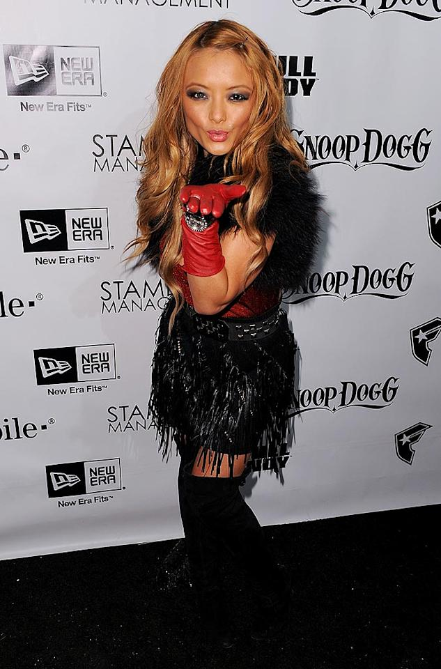 "Vamping it up in feathers and red gloves, controversial TV star Tila Tequila showed off a ridiculously large engagement ring at the party, claiming that she was engaged to troubled Johnson & Johnson heiress Casey Johnson. Michael Kovac/<a href=""http://www.filmmagic.com/"" target=""new"">FilmMagic.com</a> - December 8, 2009"