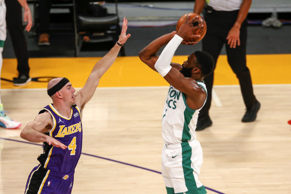 Boston Celtics' Jaylen Brown shoots over Los Angeles Lakers' Alex Caruso (4) during the first half of an NBA basketball game, Thursday, April 15, 2021, in Los Angeles. (AP Photo/Ringo H.W. Chiu)