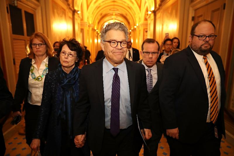 Former comedian Al Franken (center) announced his resignation on Thursday in an emotional and defiant address from the Senate floor (AFP Photo/CHIP SOMODEVILLA)
