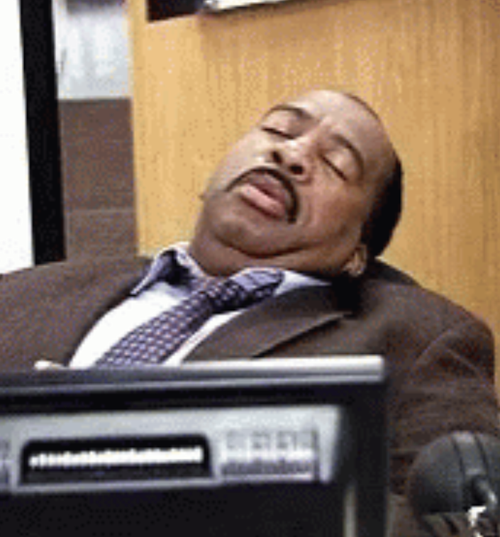 """Stanley from """"The Office"""" sleeping at his desk"""