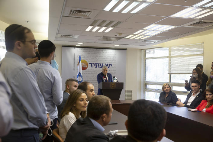 Yesh Atid party leader Yair Lapid speaks to journalists at the Knesset, Israel's Parliament, Monday, June 7, 2021. (AP Photo/Maya Alleruzzo)
